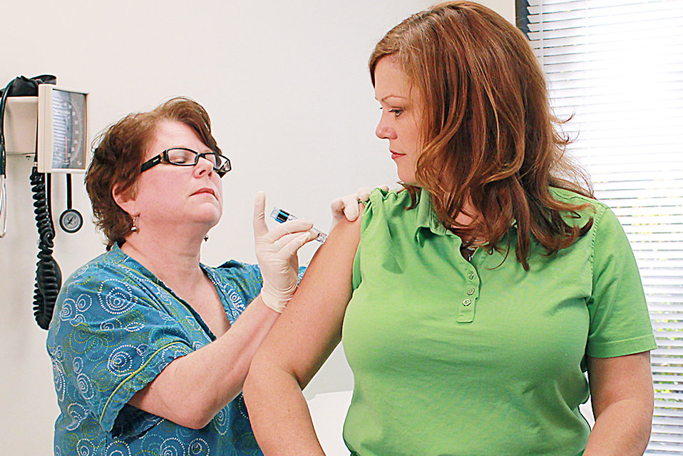 Nurse giving vaccine injection